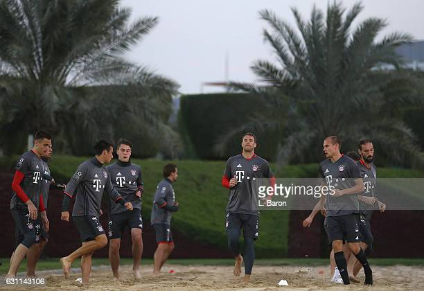 Goalkeeper Manuel Neuer warms up with team mates during a training session at day 5 of the Bayern Muenchen training camp at Aspire Academy on January...