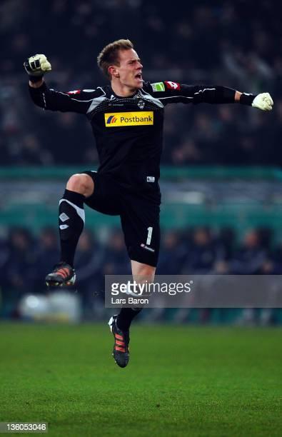 Goalkeeper MArc Andre Ter Stegen celebrates after team mate Juan Arango scored his teams first goal during the DFB Cup round of sixteen match between...