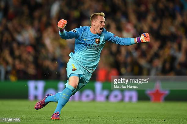 Goalkeeper Marc-Andre ter Stegen of Barcelona celebates as teammate Lionel Messi scores the opening goal during the UEFA Champions League Semi Final,...