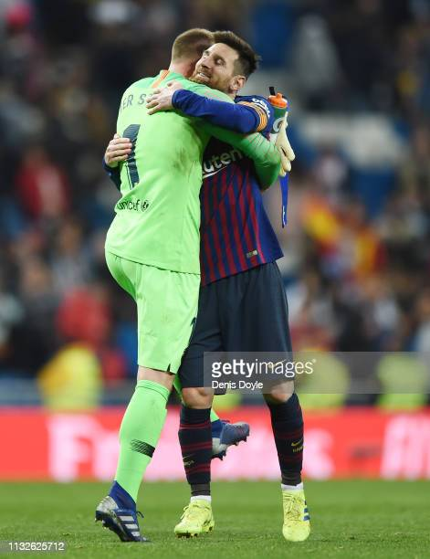 Goalkeeper Marc-Andre ter Stegen of FC Barcelona hugs Lionel Messi after the Copa del Rey Semi Final second leg match between Real Madrid and FC...