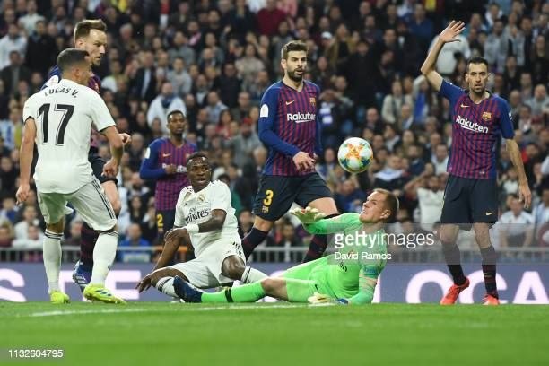 Goalkeeper MarcAndre ter Stegen of FC Barcelona makes a save against Vinicius Junior of Real Madrid during the Copa del Rey Semi Final second leg...