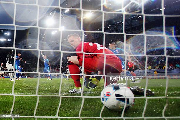 Goalkeeper MarcAndre ter Stegen of Germany lets in a header from Juray Kucka of Slovakia during the international friendly match between Germany and...