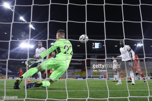 Goalkeeper Marc-Andre ter Stegen of Germany makes a save during the FIFA World Cup 2022 Qatar qualifying match between Germany and North Macedonia at...