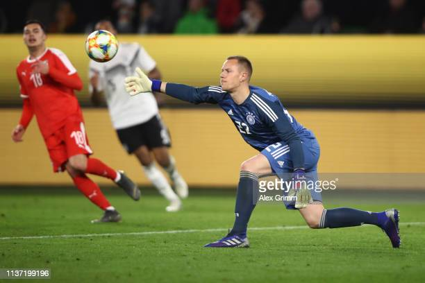 Goalkeeper MarcAndre ter Stegen of Germany throws the ball during the International Friendly match between Germany and Serbia at Volkswagen Arena on...