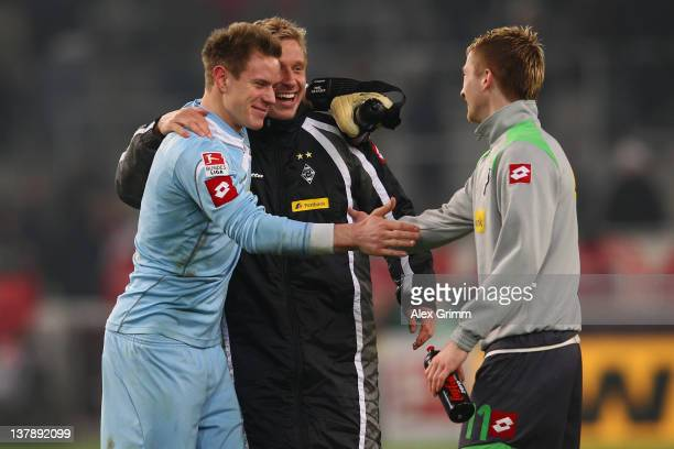 Goalkeeper MarcAndre ter Stegen of Moenchengladbach celebrates with team mates Mike Hanke and Marco Reus after the Bundesliga match between VfB...