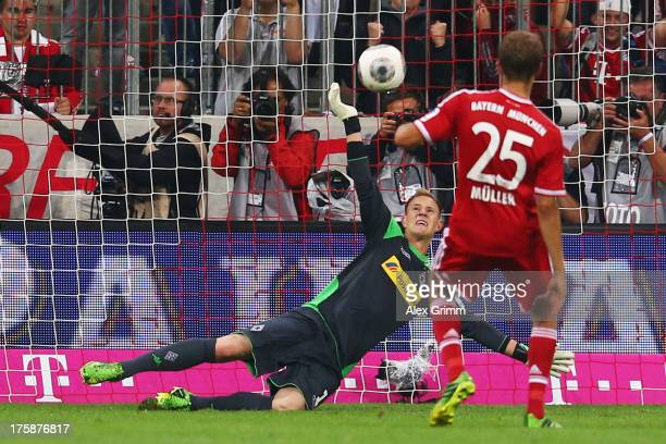 Goalkeeper MarcAndre ter Stegen of Moenchengladbach saves a penalty from Thomas Mueller of Muenchen during the Bundesliga match between Bayern...