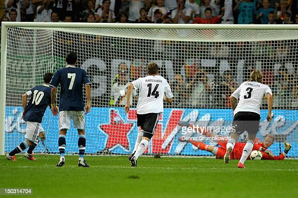 Goalkeeper MarcAndre terStegen of Germany saves a penalty shot by Lionel Messi of Argentina during the international friendly match between Germany...
