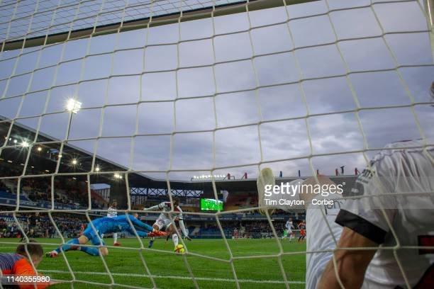 Goalkeeper MarcAurele Caillard of Guingamp dives on the ball after Mehdi Merghem of Guingamp made a spectacular goal line clearance while challenged...
