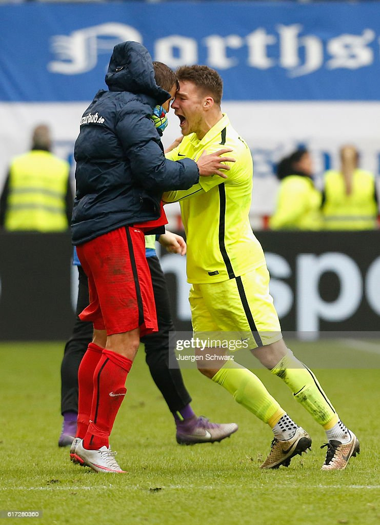 Goalkeeper Marcel Schuhen of Rostock (R) celebrates with Marcel Ziemer after the third league match between MSV Duisburg and Hansa Rostock at Schauinsland-Reisen-Arena on October 22, 2016 in Duisburg, Germany.