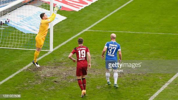 Goalkeeper Marcel Schuhen of SV Darmstadt 98, Dennis Borkowski of 1. FC Nuernberg and Patrick Herrmann of SV Darmstadt 98 during the Second...