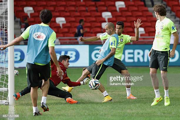 Goalkeeper Marcelo Grohe of Brazil in action during the team training session at the National Stadium on October 13 2014 in Singapore Brazil is...