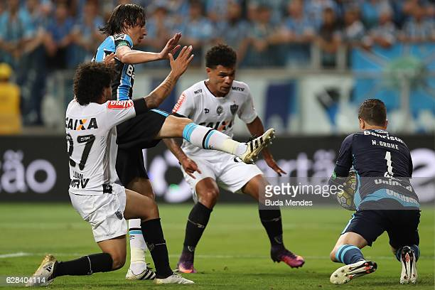 goalkeeper Marcelo Grohe of Gremio struggles for the ball with Luan of Atletico MG during a match between Gremio and Atletico MG as part of Copa do...