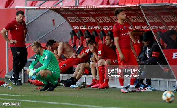 Goalkeeper Marco Knaller of Ingolstadt and his team mates are looking dejected after the 2. Bundesliga playoff second leg match between FC Ingolstadt...