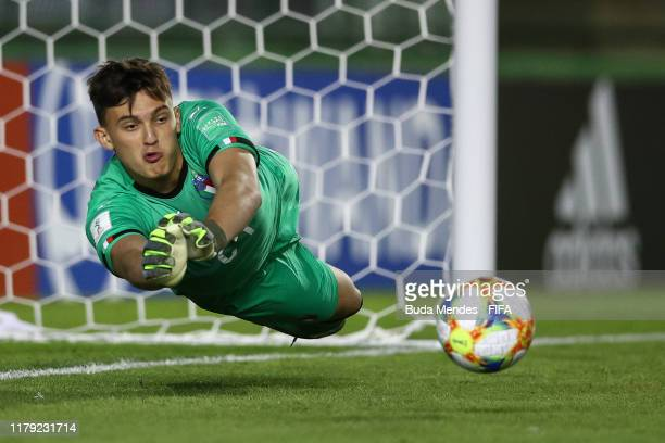 Goalkeeper Marco Molla of Italy dives to stop the ball during the FIFA U17 Men's World Cup Brazil 2019 group F match between Mexico and Italy at...