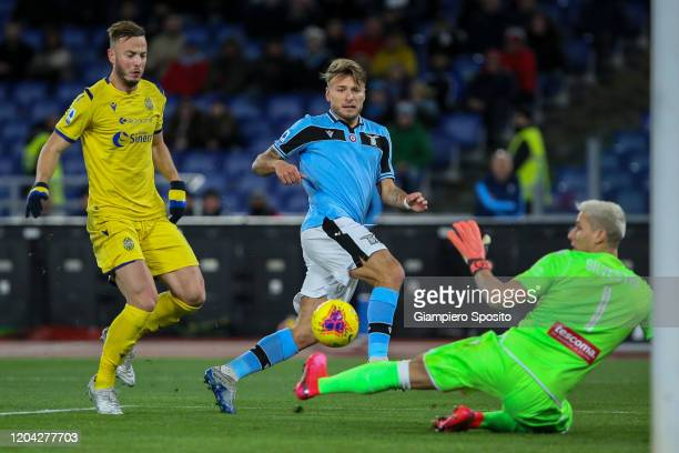 Goalkeeper Marco Silvestri of Hellas Verona makes a save against Ciro Immobile of SS Lazio during the Serie A match between SS Lazio and Hellas...