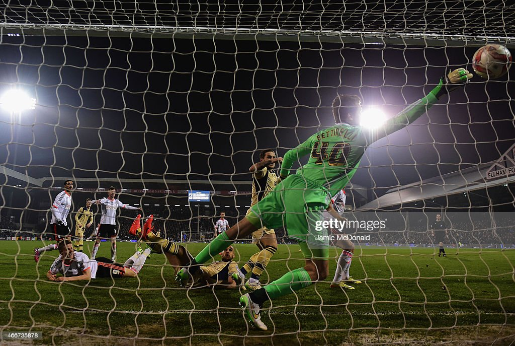 Goalkeeper Marcus Bettinelli of Fulham fails to stop Souleymane Bamba of Leeds United (not pictured) from scoring their second goal during the Sky Bet Championship match between Fulham and Leeds United at Craven Cottage on March 18, 2015 in London, England.