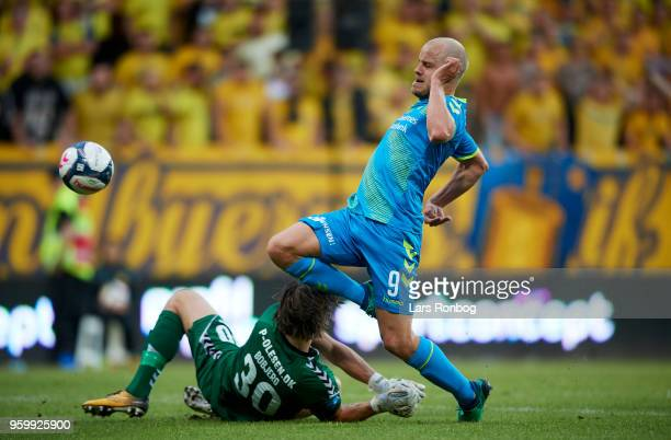 Goalkeeper Marcus Bobjerg of AC Horsens and Teemu Pukki of Brondby IF compete for the ball during the Danish Alka Superliga match between AC Horsens...