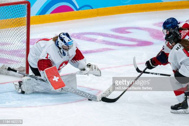 Goalkeeper Margaux Favre of Switzerland battles for the puck with Natalie Brichova of Czech Republic during Women's 6-Team Tournament Preliminary...