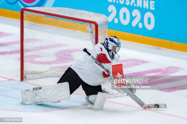 Goalkeeper Margaux Favre of Switzerland controls the puck during Women's 6-Team Tournament Preliminary Round - Group B Game between Czech Republic...