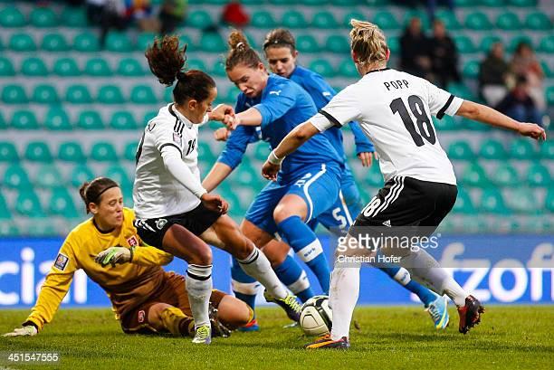 Goalkeeper Maria Korenciova and Lucie Harsanyova of Slovakia compete for the ball with Fatmire Bajramaj and Alexandra Popp of Germany during the FIFA...