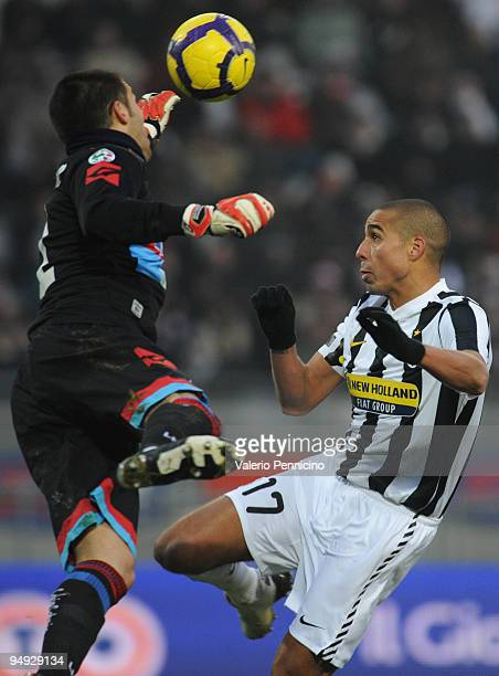 Goalkeeper Mariano Andujar of Catania Calcio in action against David Trezeguet of Juventus during the Serie A match between Juventus FC and Catania...
