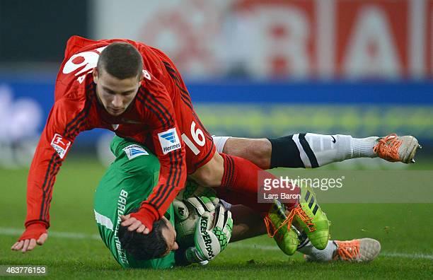 Goalkeeper Marjan Petkovic of Braunschweig is challenged by Maximilian Wagener of Leverkusen during the Stadtwerke Duesseldorf Wintercup 2014 final...