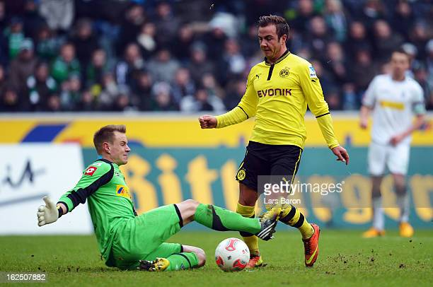 Goalkeeper Mark Andre Ter Stegen of Moenchengladbach challenges Mario Goetze of Dortmund during the Bundesliga match between VfL Borussia...