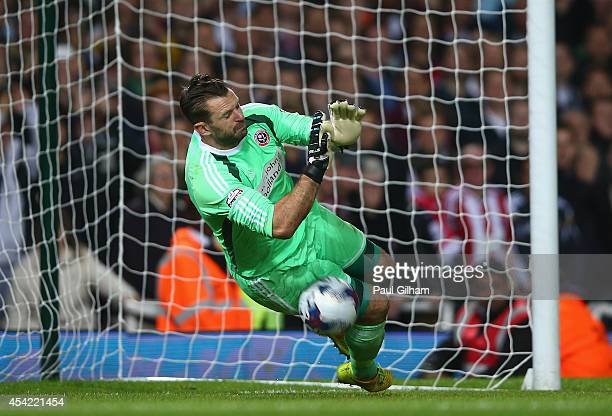 Goalkeeper Mark Howard of Sheffield United saves the penalty in a penalty shoot out from Enner Valencia of West Ham United resulting in Sheffield...
