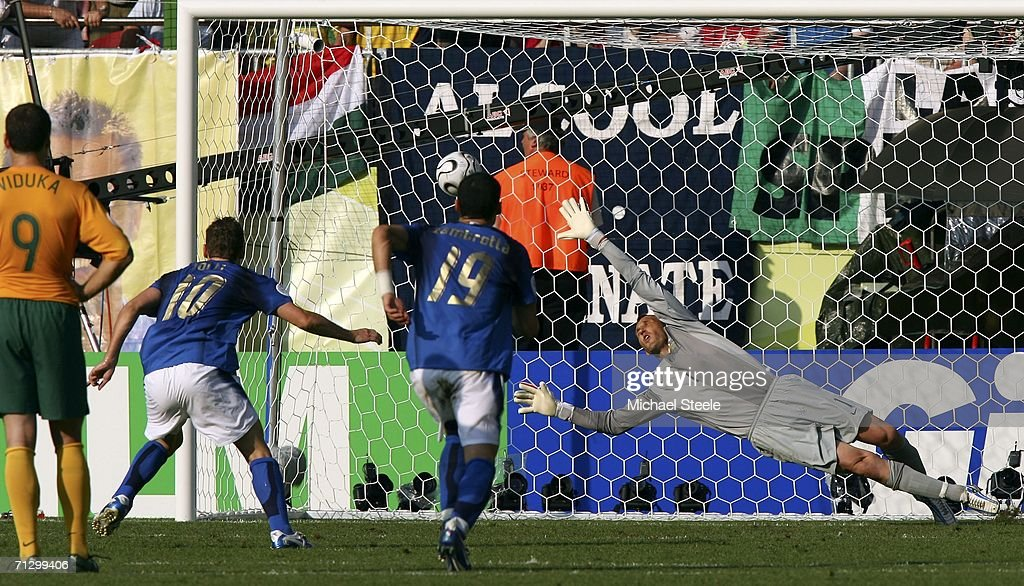 Goalkeeper Mark Schwarzer of Australia, dives in vain as the match winning penalty from Francesco Totti #10 (2nd L) of Italy, flies into the net during the FIFA World Cup Germany 2006 Round of 16 match between Italy and Australia at the Fritz-Walter Stadium on June 26, 2006 in Kaiserslautern, Germany.