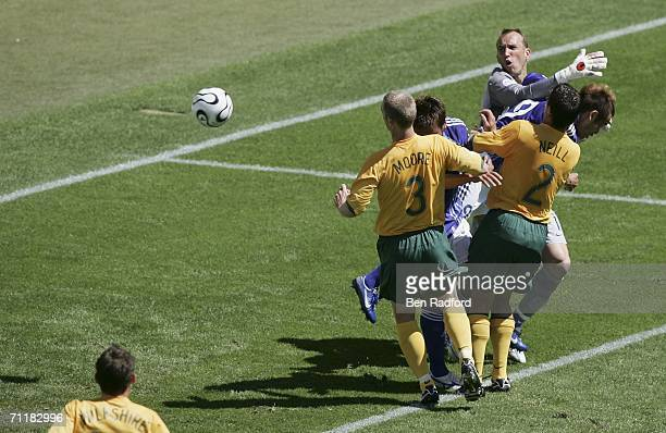 Goalkeeper Mark Schwarzer of Australia fails to gather a cross from Shunsuke Nakamura of Japan which ends up in the net for ther opening goal during...