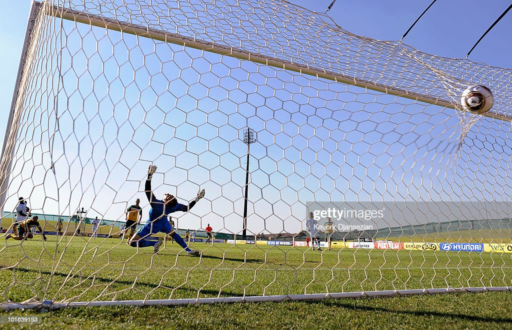 Goalkeeper Mark Schwarzer of Australia fails to stop a goal scored by Edson Buddle #14 of USA during first half of the 2010 FIFA World Cup Pre-Tournament match between the Australian Socceroos and the United States of America at Ruimsig Stadium on June 5, 2010 in Roodepoort, South Africa.