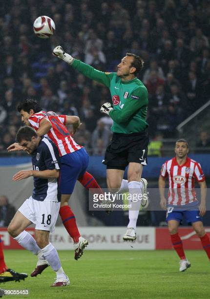 Goalkeeper Mark Schwarzer of Fulham battles for the ball with Sergio Aguero of Atletico Madrid during the UEFA Europa League final match between...