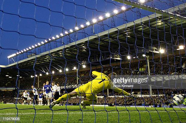 Goalkeeper Mark Schwarzer of Fulham is unable to stop Louis Saha of Everton scoring his team's 20 goal during the Barclays Premier League match...