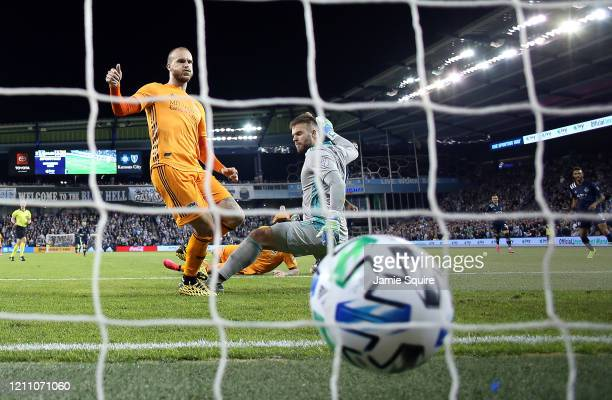 Goalkeeper Marko Maric and Aljaz Struna of Houston Dynamo let in a goal during the game against Sporting Kansas City at Children's Mercy Park on...