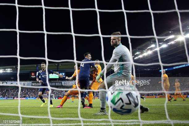 Goalkeeper Marko Maric of Houston Dynamo looks back as he lets in a goal during the game against Sporting Kansas City at Children's Mercy Park on...
