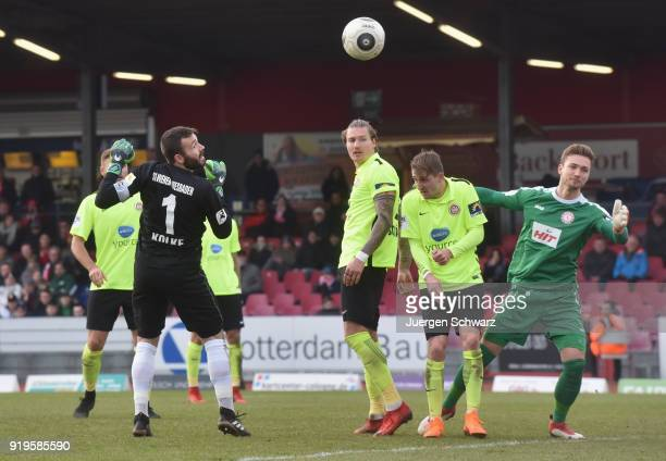 Goalkeeper Markus Kolke of Wiesbaden acts like a forward near goalkeeper Tim Boss of Cologne during the 3 Liga match between SC Fortuna Koeln and SV...
