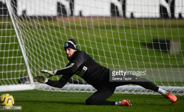 Goalkeeper Martin Dubravka dives to make a save during the Newcastle United Training Session at the Newcastle United Training Centre on January 13...