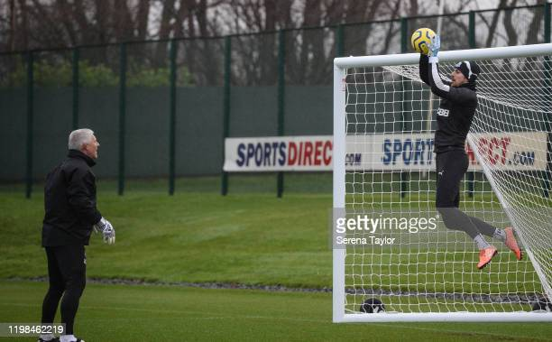 Goalkeeper Martin Dubravka jumps in the air as Goalkeeping Coach Simon Smith runs a drill during the Newcastle United Training Session at the...