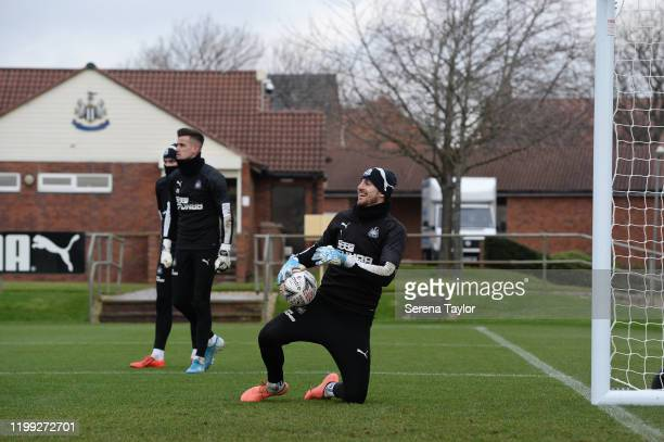 Goalkeeper Martin Dubravka kneels on the grass holding the ball during the Newcastle United Training Session at the Newcastle United Training Centre...