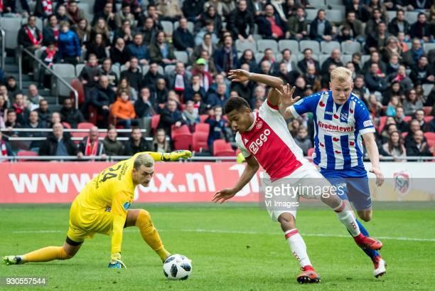 goalkeeper Martin Hansen of sc Heerenveen David Neres of Ajax Lucas Woudenberg of sc Heerenveen during the Dutch Eredivisie match between Ajax...
