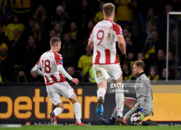 Goalkeeper Marvin Schwabe of Brondby IF saves the shot from Rasmus Thellufsen of AaB Aalborg during the Danish Superliga match between Brondby IF and...