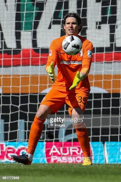 Goalkeeper Marwin Hitz of Augsburg controls the ball during the Bundesliga match between FC Augsburg and Hamburger SV at WWK Arena on April 30 2017...