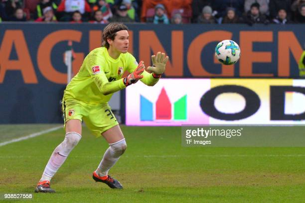 Goalkeeper Marwin Hitz of Augsburg controls the ball during the Bundesliga match between FC Augsburg and SV Werder Bremen at WWKArena on March 17...