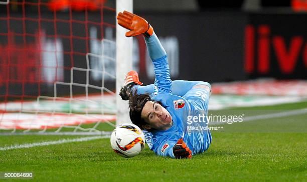 Goalkeeper Marwin Hitz of Augsburg holds a penalty during the Bundesliga match between 1 FC Koeln and FC Augsburg at RheinEnergieStadion on December...