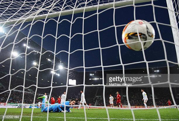 Goalkeeper Marwin Hitz of Augsburg looks on as Robert Lewandowski of Bayern Munich scores their first goal during the Bundesliga match between FC...
