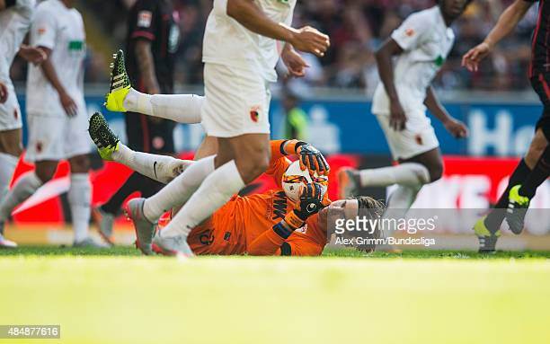Goalkeeper Marwin Hitz of Augsburg makes a save during the Bundesliga match between Eintracht Frankfurt and FC Augsburg at CommerzbankArena on August...
