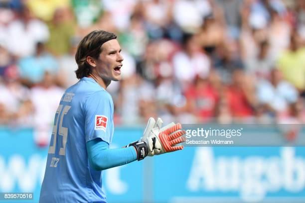 Goalkeeper Marwin Hitz of FC Augsburg gestures during the Bundesliga match between FC Augsburg and Borussia Moenchengladbach at WWKArena on August 26...