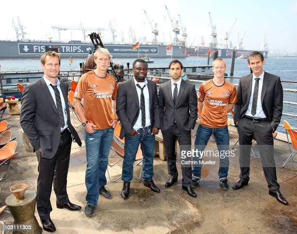 Goalkeeper Mathias Hain Marius Ebbers Gerald Asamoah Fabio Morena Timo Schultz and Thomas Kessler pose during the FC St Pauli street wear...