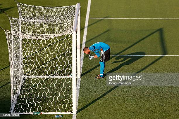 Goalkeeper Matt Pickens of Colorado Rapids pauses in the goal mouth prior to facing Real Salt Lake at Dick's Sporting Goods Park on August 4 2012 in...