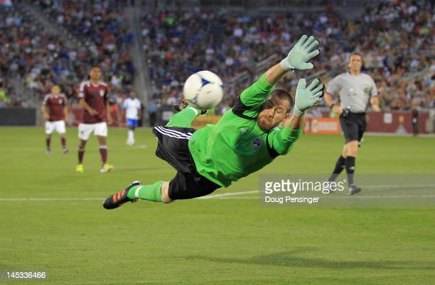 Goalkeeper Matt Pickens of the Colorado Rapids dives to make a save against the Montreal Impact at Dick's Sporting Goods Park on May 26 2012 in...